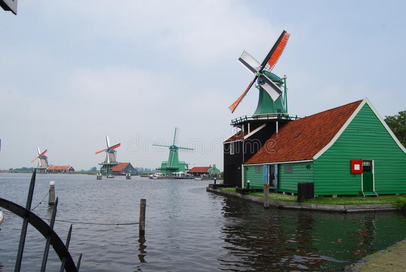 Dutch windmills at Zaandam Time Museum. This is a pretty village in its own right, with its own houses and buildings, but where examples of old Dutch windmills stock images