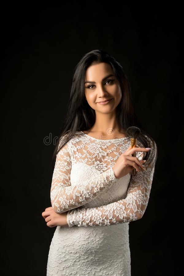 Pretty visagiste in lace dress waist up portrait stock photos