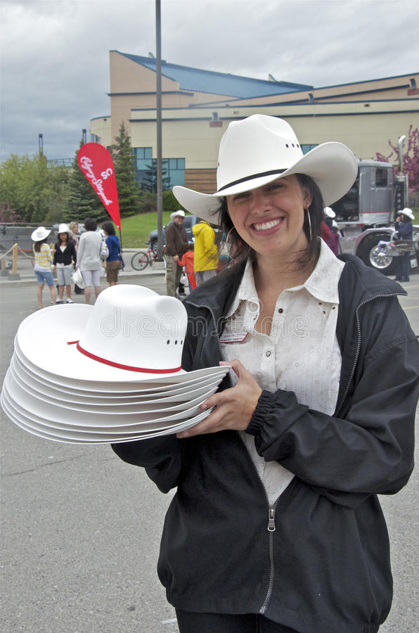 Pretty Volunteer With White Cowboy Hats Editorial