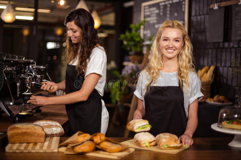 Pretty waitresses behind the counter working royalty free stock photo