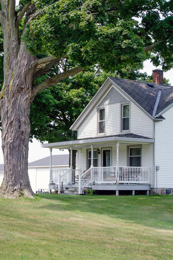 Pretty white farm house in USA royalty free stock photography