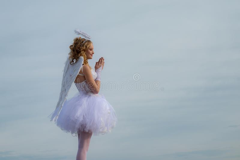 Pretty white little girl as the cupid congratulating on St Valentines day. Innocent Girl with angel wings standing with stock images