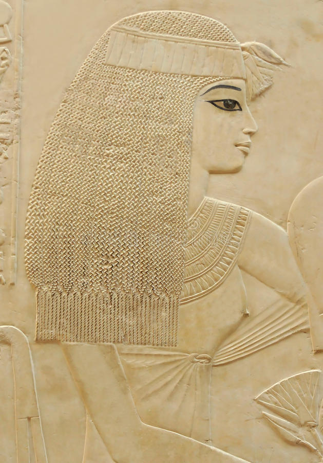 Pretty Woman. Bas-relief portrait of a Pretty woman in topless dress and frizzy hair from the Tomb of Ramose in the ancient egyptian necropolis of the nobles at stock photography