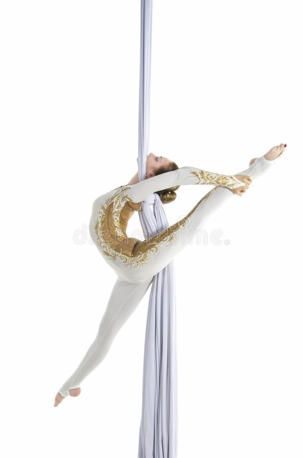 Pretty woman - aerialist performing aerial tricks on aerial silks. stock image
