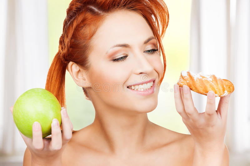 Pretty Woman With Apple And Cake Royalty Free Stock Images