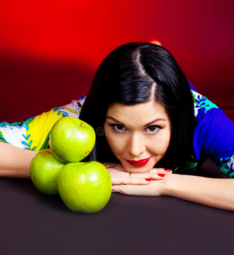 Pretty woman with apples royalty free stock photos