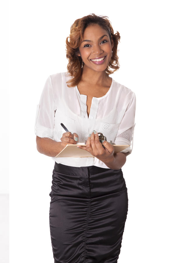 Pretty woman with a big smile holds a clipboard. stock images