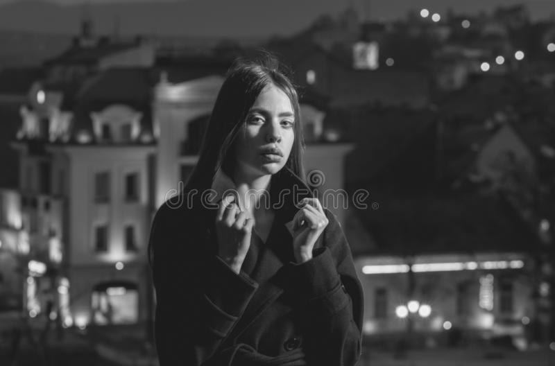 Pretty woman in black coat at night city royalty free stock photos