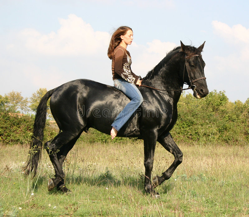 Download Pretty Woman And Black Horse Stock Image - Image: 2133881