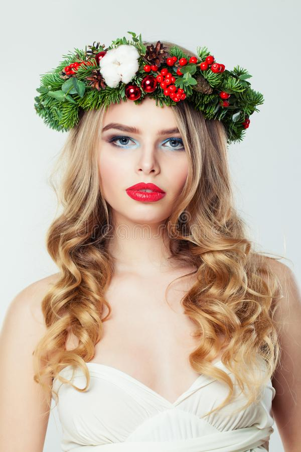 Pretty woman with blonde curly hair and red lips makeup, Christmas concept stock images