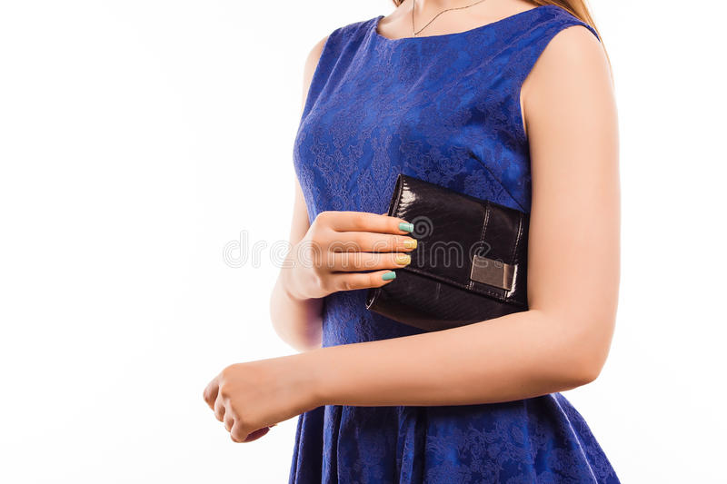 Pretty woman in blue dress with black bag clutch. Fashion concept. royalty free stock images