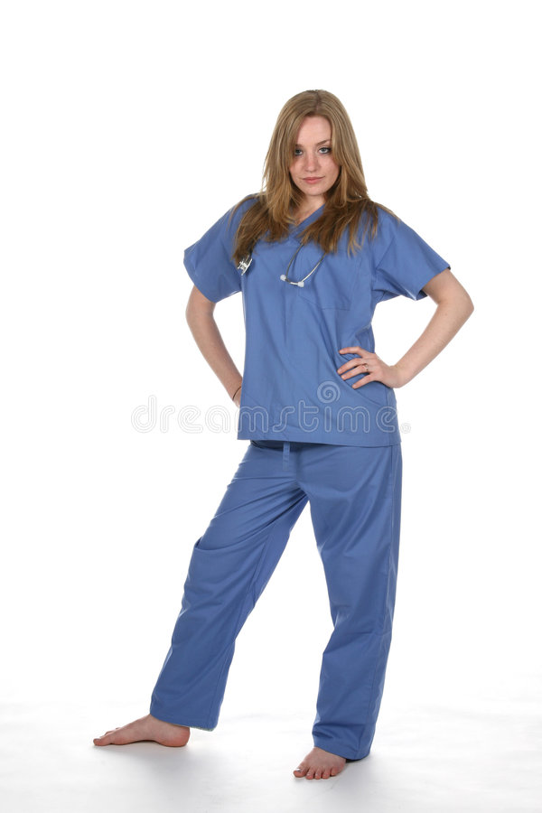 Pretty woman in blue medical scrubs. Pretty young woman wearing blue medical scrubs and a stethoscope royalty free stock images