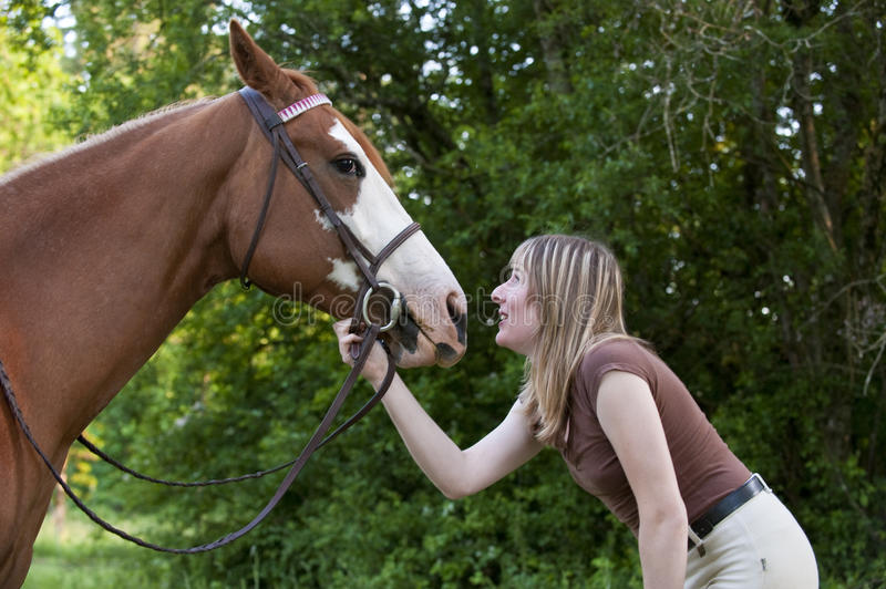 Pretty woman bonding with her horse royalty free stock photo