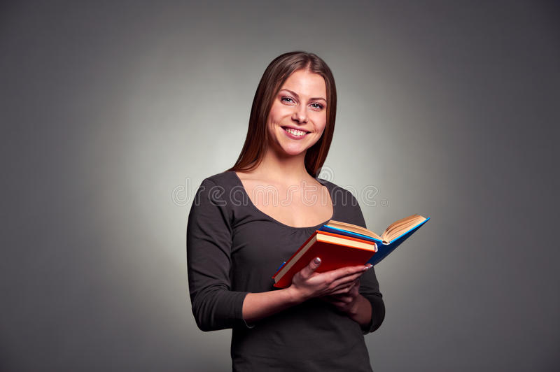 Download Pretty woman with books stock photo. Image of face, holding - 28771906