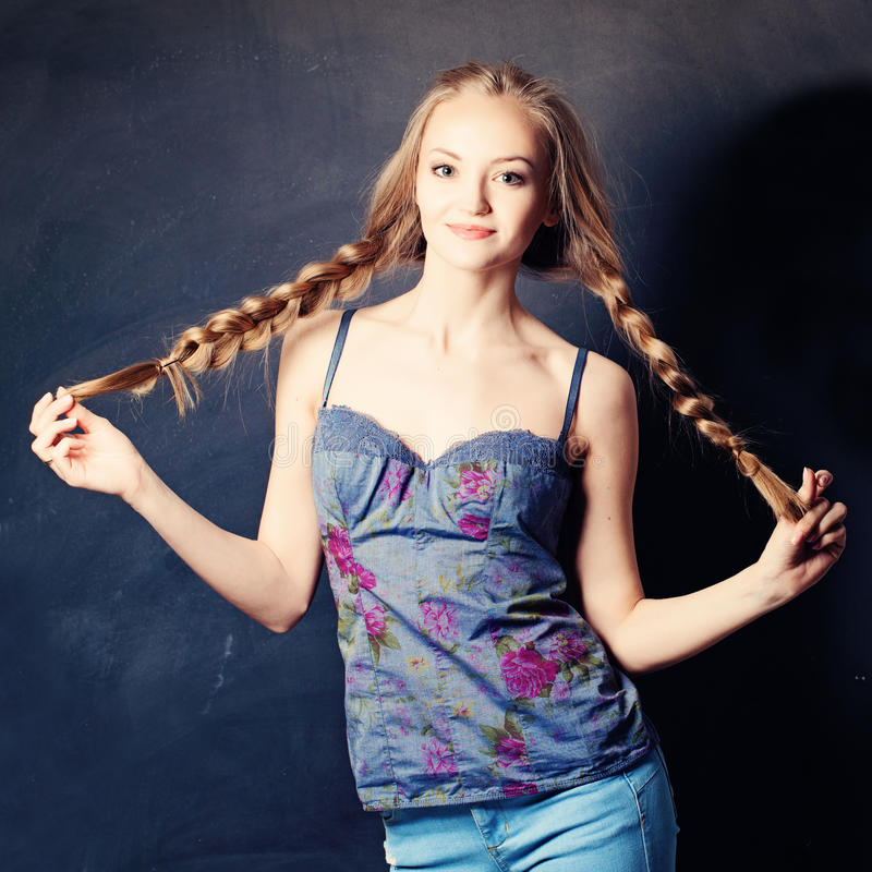 Pretty Woman with Braids. On Background stock photos
