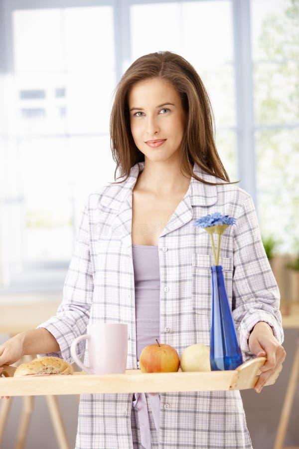 Pretty woman with breakfast tray