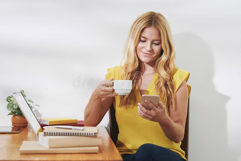 Pretty woman checking text messages stock images