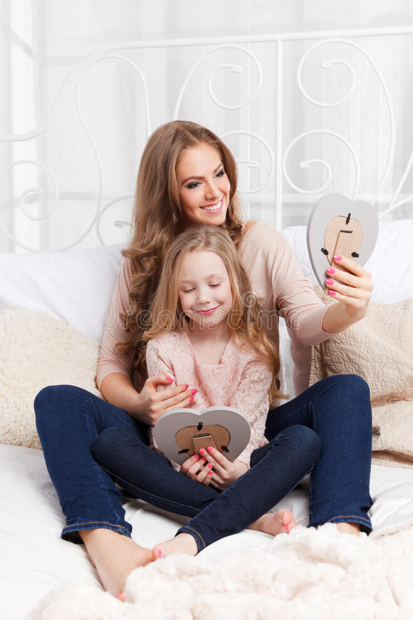 Pretty Woman And Child Holding Picture Frames Stock Photo - Image of ...