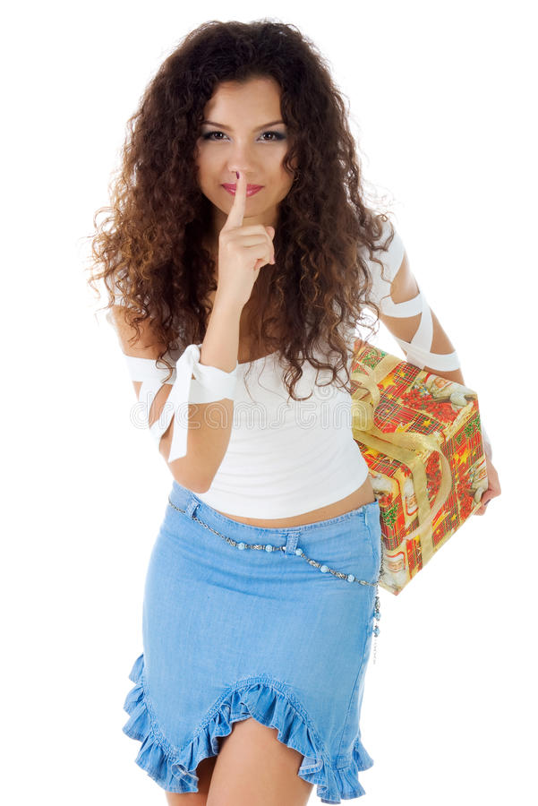 Pretty woman with a christmas gift royalty free stock image