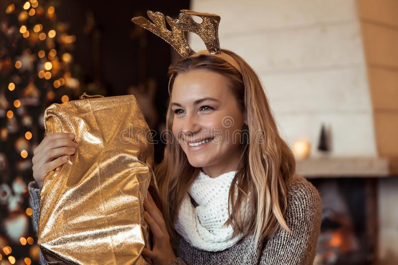Pretty woman with Christmas gift stock image