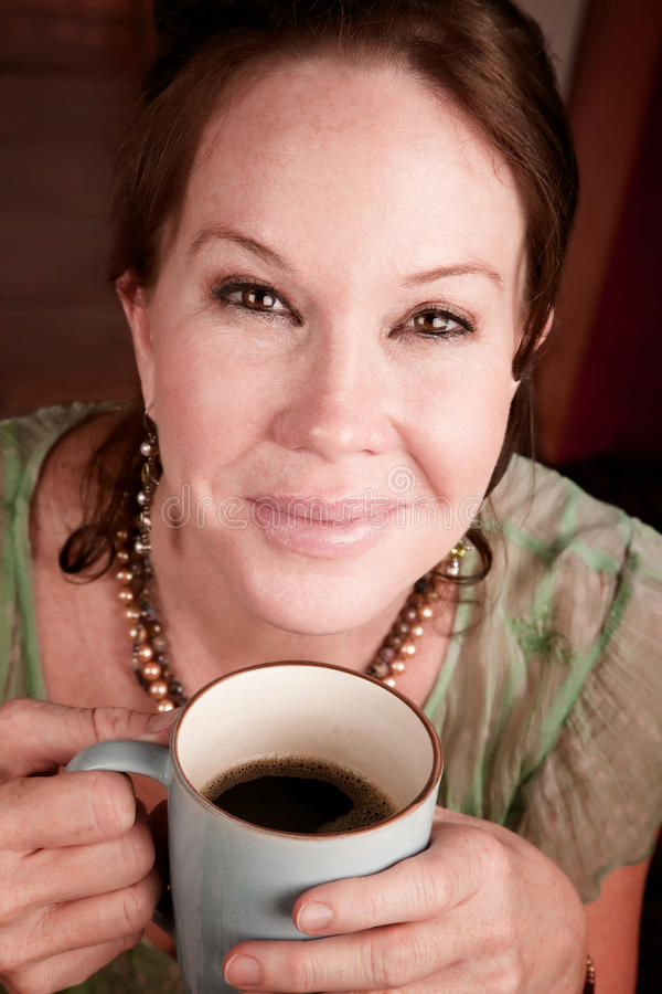 Pretty woman with coffee royalty free stock photography