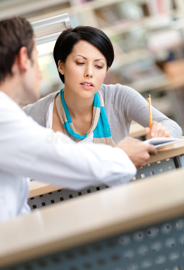 Download Pretty Woman Communicates With Man At The Library Stock Photo - Image: 27366328