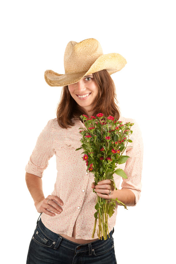 Pretty woman with cowboy hat and flowers