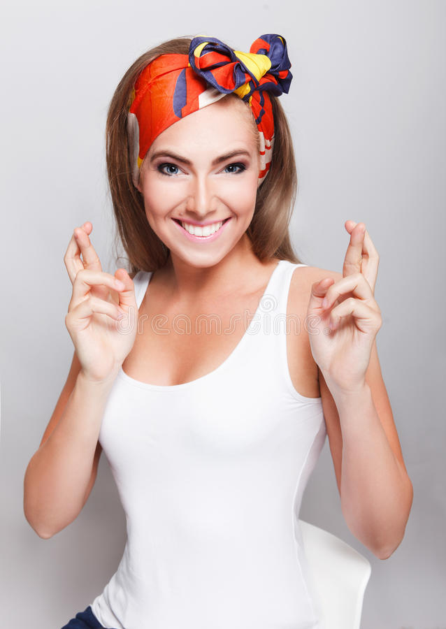 Free Pretty Woman Crossing Her Fingers For Good Luck Stock Image - 56121431