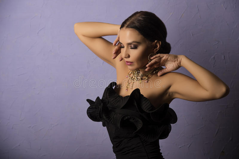 Pretty woman in dlack dress royalty free stock images