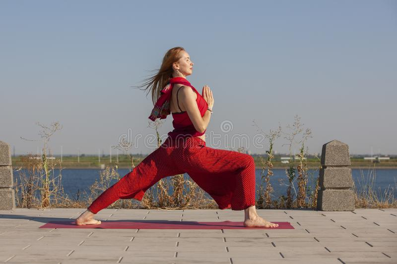Pretty woman doing yoga exercises in the park. Portrait stock images