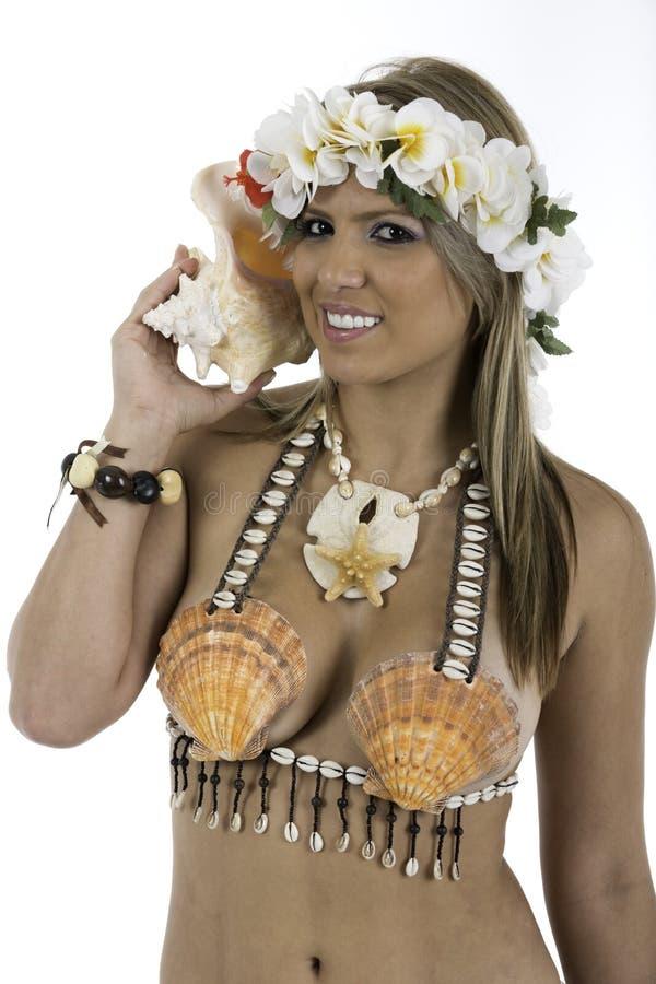 Pretty woman dressed in Hawaiian costume stock photo