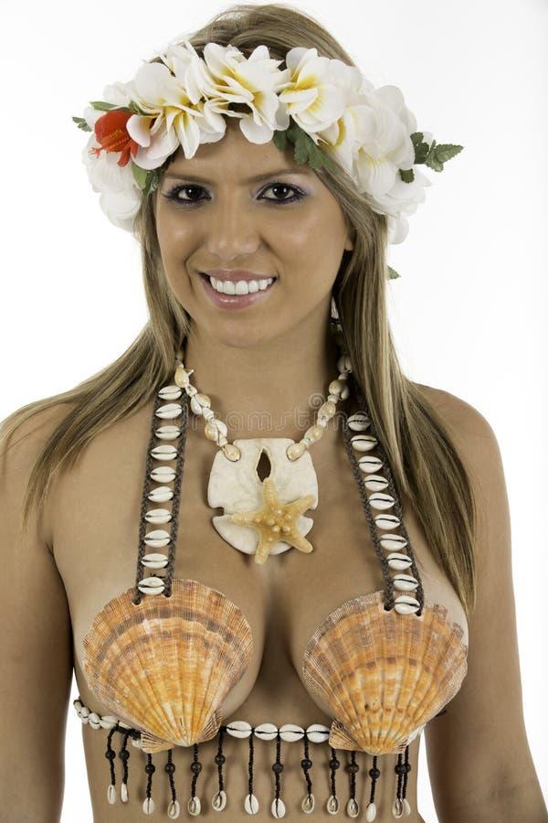 Pretty woman dressed in Hawaiian costume stock photography
