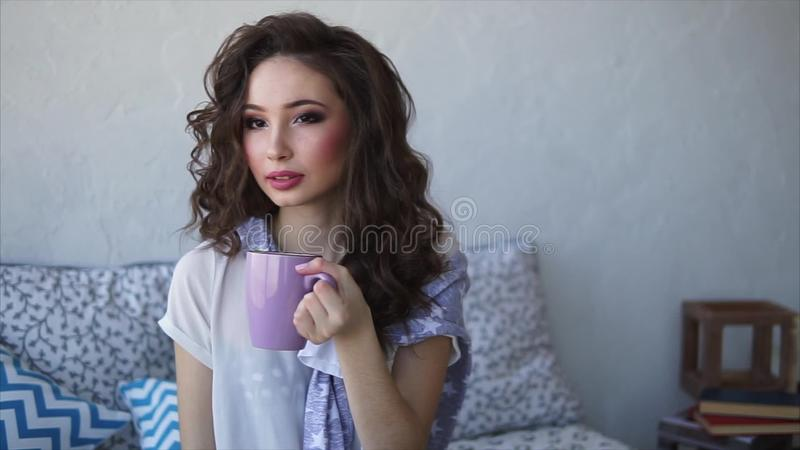 046b9f96736a Pretty Woman Dressed In Pajamas Drinks Morning Coffee In Her Bedroom. Stock  Video - Video of food