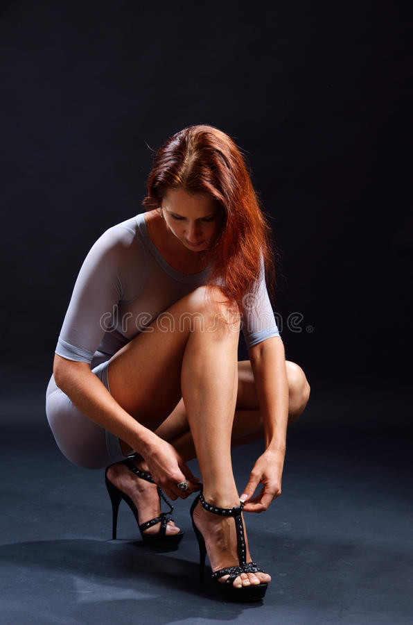 Pretty woman dressing high heels stock photography