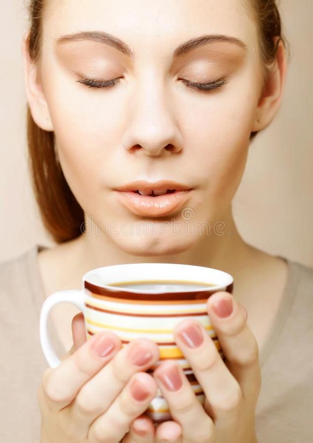 pretty woman drinking coffee royalty free stock image