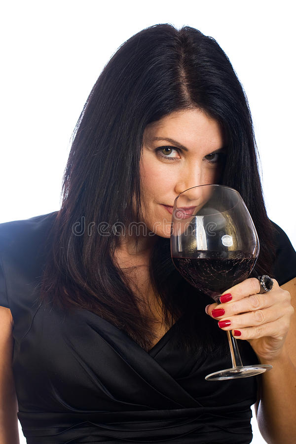 Pretty woman drinking red wine stock photography