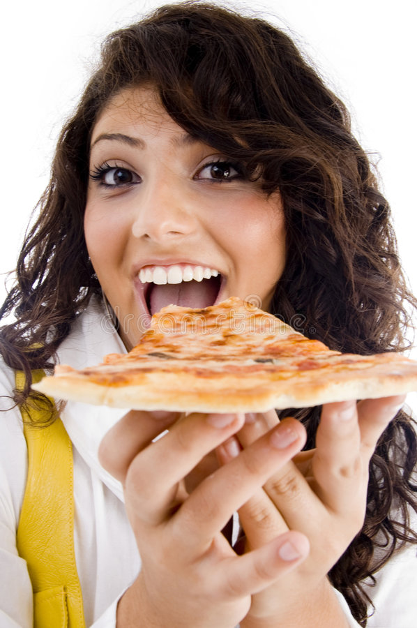 Pretty woman eating delicious pizza stock images