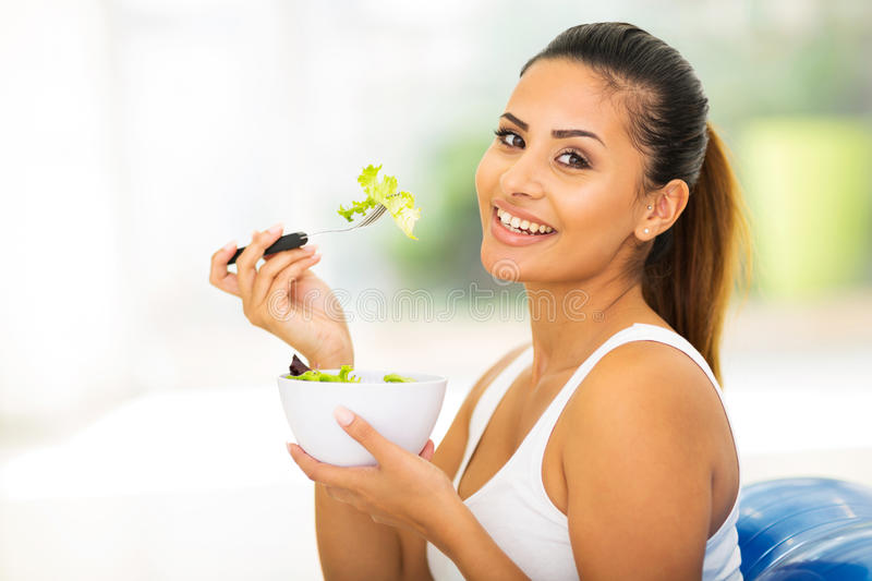 Pretty woman eating healthy. Food at home stock photo