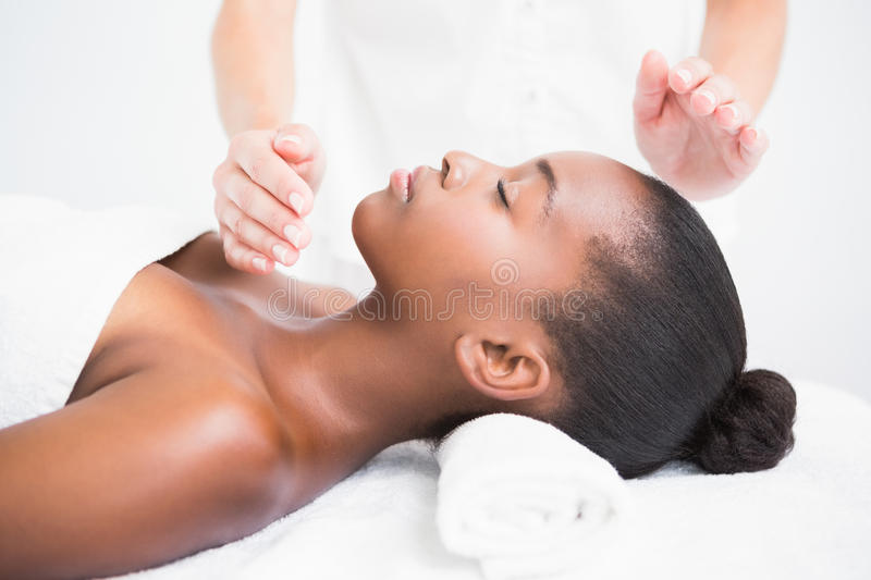 Pretty woman enjoying a reiki technique stock images
