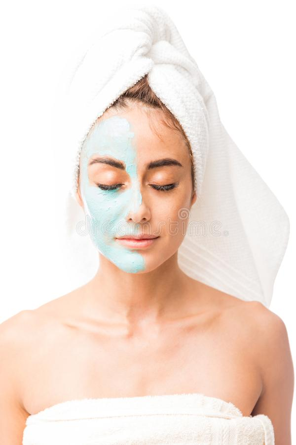 Pretty Woman With Eyes Closed And Face Mask In Studio stock images