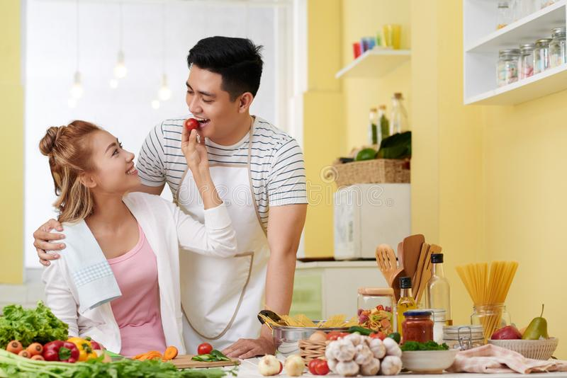Pretty woman feeding boyfriend stock photography