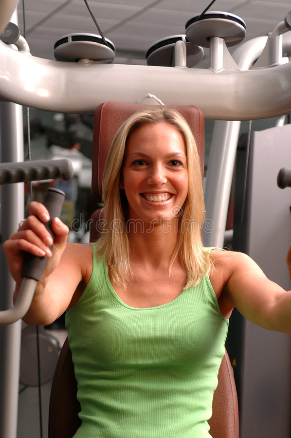 Pretty woman in fitness center stock photos