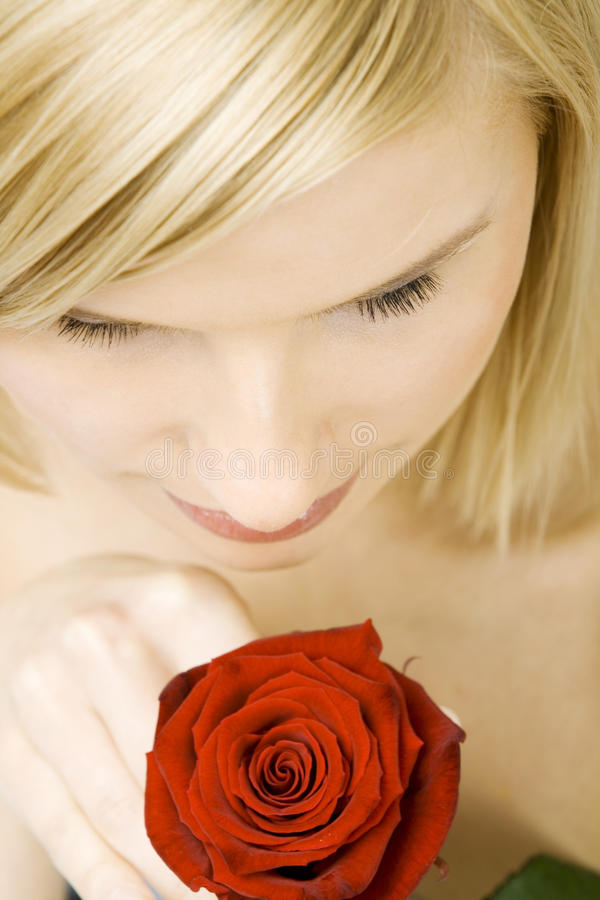 Pretty woman with a flower royalty free stock photo