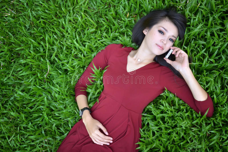 Pretty woman in the garden stock photography