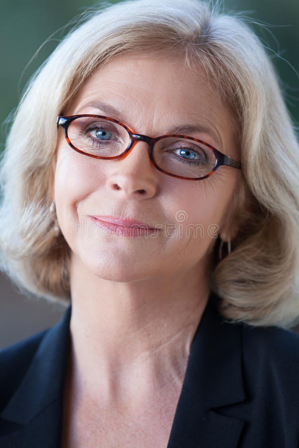 Pretty woman in glasses stock image