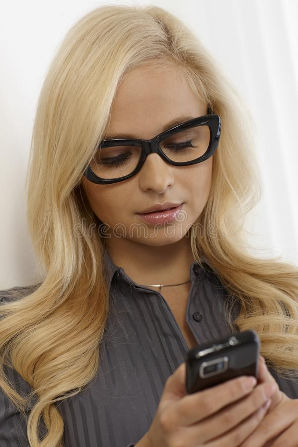 Download Pretty Woman In Glasses Using Mobile Stock Photos - Image: 29438403