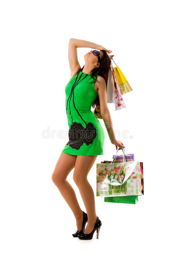 Download Pretty Woman In Green And Bags Stock Photo - Image: 8648592
