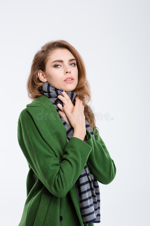 Pretty woman in green coat and scarf royalty free stock image