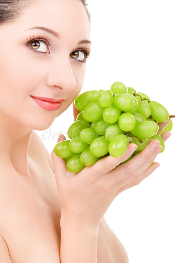 Pretty woman with green grape stock images