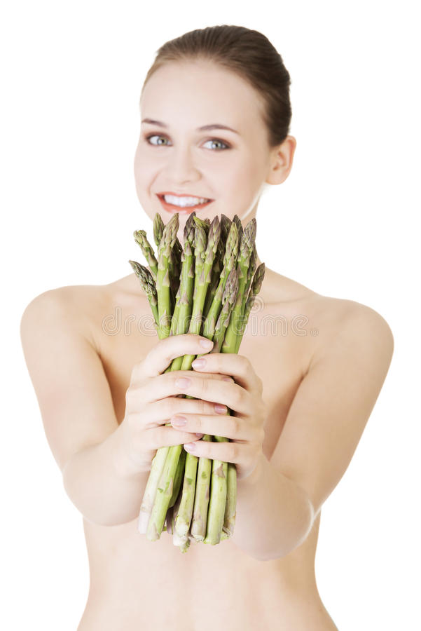 Pretty woman with healthy food - asparagus. Isolated on white stock image